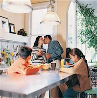 Family in a Kitchen in the Morning Stock Photo - Premium Royalty-Freenull, Code: 6106-06995773