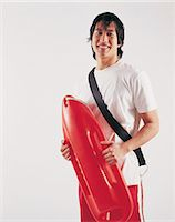 Portrait of a Japanese Lifeguard Stock Photo - Premium Royalty-Freenull, Code: 6106-06996111