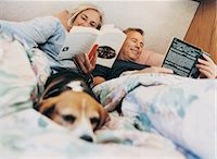 Couple Reading in Bed in Their Motor Home Stock Photo - Premium Royalty-Freenull, Code: 6106-06996820