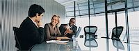 Businessmen Listening to a Female CEO Talking in a Meeting Room Stock Photo - Premium Royalty-Freenull, Code: 6106-06997495