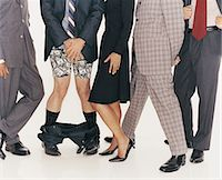 Group of Businessmen and a Businesswoman Standing in a Line and a Businessman With His Trousers Down Stock Photo - Premium Royalty-Freenull, Code: 6106-06997718