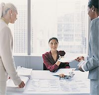 secretary desk - Business Women Collect Information on Arrival at a Conference Centre Stock Photo - Premium Royalty-Freenull, Code: 6106-06998200