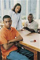 Parents Reprimanding Their Teenage Son, Sitting With Cigarettes Stock Photo - Premium Royalty-Freenull, Code: 6106-06998235