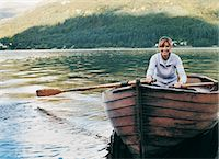 side view of person rowing in boat - Mature Woman Rowing a Boat on a Lake Stock Photo - Premium Royalty-Freenull, Code: 6106-06998305