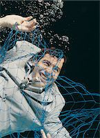 Businessman Underwater Trapped in a Net Stock Photo - Premium Royalty-Freenull, Code: 6106-06998861
