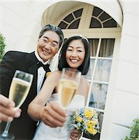 Portrait of a Bride and Groom With Champagne By Some French Windows Stock Photo - Premium Royalty-Freenull, Code: 6106-06998942