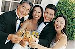 Portrait of a Bride and Groom With a Man and a Woman Making a toast With Champagne Stock Photo - Premium Royalty-Freenull, Code: 6106-06998946
