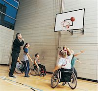 Teacher With Secondary School Students, Some in Wheelchairs, Playing Basketball Stock Photo - Premium Royalty-Freenull, Code: 6106-06999744