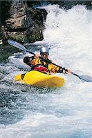 Canoist Canoeing in Rapids Stock Photo - Premium Royalty-Freenull, Code: 6106-06999876