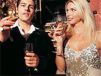 Couple Drinking Champagne and Smoking a Cigar Stock Photo - Premium Royalty-Freenull, Code: 6106-06999956