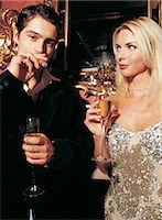 A Couple Drinking Champagne and Smoking a Cigar Stock Photo - Premium Royalty-Freenull, Code: 6106-06999958
