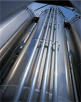 refinery - Low Angle View of Pipelines in an Oil Refinery Stock Photo - Premium Royalty-Freenull, Code: 6106-07000330