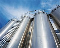 refinery - Low Angle View of Storage Tanks and Pipelines in an Oil Refinery Stock Photo - Premium Royalty-Freenull, Code: 6106-07000331