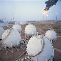 refinery - Storage Tanks at an Oil Refinery With Smokestacks in the Background, United Arab Emirates Stock Photo - Premium Royalty-Freenull, Code: 6106-07000334