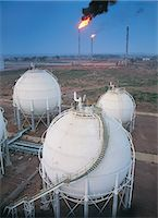 refinery - Storage Tanks at an Oil Refinery Stock Photo - Premium Royalty-Freenull, Code: 6106-07000341