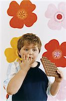 preteens fingering - Young Boy Eating a Large Chocolate Bar Stock Photo - Premium Royalty-Freenull, Code: 6106-07000742
