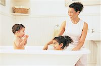Mother Watching Her Son and Daughter Having a Bath Stock Photo - Premium Royalty-Freenull, Code: 6106-07001170