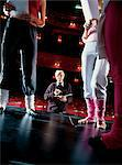 Theatre Director Looking up at Dancers Standing on Stage Stock Photo - Premium Royalty-Freenull, Code: 6106-07001848