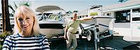 Couple Standing on a Motorboat, Showroom Forecourt Stock Photo - Premium Royalty-Freenull, Code: 6106-07002243