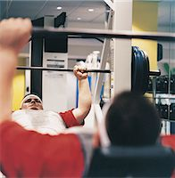 fat man exercising - Man Lifting a Dumbbell in a Gym Stock Photo - Premium Royalty-Freenull, Code: 6106-07002439