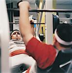 Man Weight Training in a Gym
