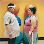 Overweight Man and Woman Standing Face to Face in a Gym Stock Photo - Premium Royalty-Freenull, Code: 6106-07002441