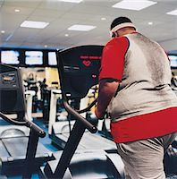 fat man exercising - Rear View of a Man Walking on a Running Machine Stock Photo - Premium Royalty-Freenull, Code: 6106-07002450