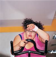 fat lady sitting - Fat Woman on an Exercise Bike Stock Photo - Premium Royalty-Freenull, Code: 6106-07002453