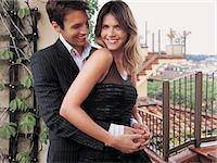 Young Couple Embracing on a City Roof Garden Stock Photo - Premium Royalty-Freenull, Code: 6106-07002512