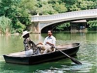 side view of person rowing in boat - Couple Sit Opposite Each Other in a Rowing Boat on a River in Central Park, Laughing Stock Photo - Premium Royalty-Freenull, Code: 6106-07002612