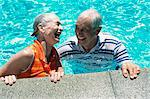 Elderly Couple in a Swimming Pool Wearing Wet T-shirts