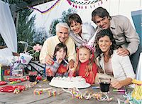 streamer - Family of Six Celebrate a Birthday With Cake, Bunting and Party Streamers Stock Photo - Premium Royalty-Freenull, Code: 6106-07002739