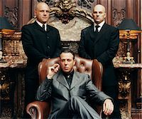 Wealthy Criminal Sitting in an Armchair Between two Bodyguards Stock Photo - Premium Royalty-Freenull, Code: 6106-07002848