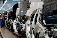 Men Working on a Car Assembly Line in a Factory Stock Photo - Premium Royalty-Freenull, Code: 6106-07002966