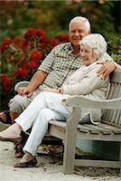 people sitting on bench - A Senior Couple Sittng on a Park Bench Stock Photo - Premium Royalty-Freenull, Code: 6106-07003352