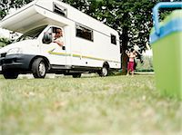 Young Girl Directing Her Father as he Reverses a Motor Home into a Parking Space in a Field Stock Photo - Premium Royalty-Freenull, Code: 6106-07003443