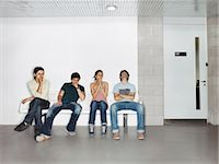 Four Young Students Sat in a Line, Looking Nervous Stock Photo - Premium Royalty-Freenull, Code: 6106-07003463
