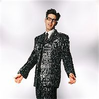 Man Wearing a Suit Made from Computer Keyboard Keys Stock Photo - Premium Royalty-Freenull, Code: 6106-07003472
