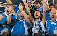 soccer fan - Football Supporters Celebrating in a Bar Stock Photo - Premium Royalty-Freenull, Code: 6106-07003613