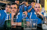 soccer fan - Group of Anxious Football Fans in a Pub Stock Photo - Premium Royalty-Freenull, Code: 6106-07003639