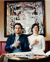 fat lady sitting - Portrait of a Blank Faced Couple in a Pub Stock Photo - Premium Royalty-Freenull, Code: 6106-07004715
