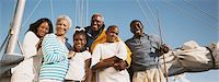 preteens pictures older men - Portrait of a Three Generational Family Standing in a Line by the Mast of a Sailing Boat, Smiling Stock Photo - Premium Royalty-Freenull, Code: 6106-07005065