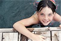 preteen girl - Young Girl in Water Holding on Wooden Pier Stock Photo - Premium Royalty-Freenull, Code: 6106-07005085