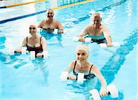 refraction - Group of Four Senior People Enjoying Weight Training in a Swimming Pool Stock Photo - Premium Royalty-Freenull, Code: 6106-07005131