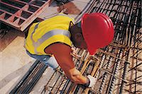 Overhead shot of worker with rods Stock Photo - Premium Royalty-Freenull, Code: 6106-07005381