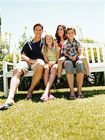 preteen thong - Family of Four Sit on a Park Bench in Summer Stock Photo - Premium Royalty-Freenull, Code: 6106-07005593
