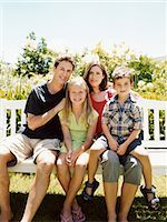 preteen thong - Family of Four Sit Together on a Park Bench in Sunlight Stock Photo - Premium Royalty-Freenull, Code: 6106-07005602