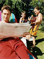 preteen touch - Man Sits Reading a Newspaper Unaware of Two Boys Aiming Water-Guns at Him Stock Photo - Premium Royalty-Freenull, Code: 6106-07005606