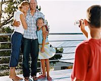 preteen thong - Young Boy Takes a Picture of His Parents and Sister Standing on Their Balcony Stock Photo - Premium Royalty-Freenull, Code: 6106-07005617