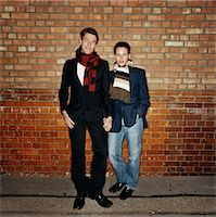 Gay Couple Lean Against a Brick Wall Holding Hands Stock Photo - Premium Royalty-Freenull, Code: 6106-07005840